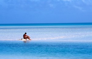 swim A quiet moment in Aitutaki Lagoon.