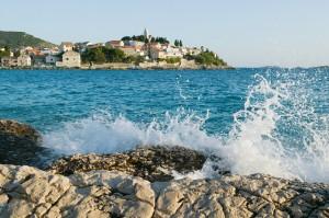 swim Sea splashing rocks at primosten